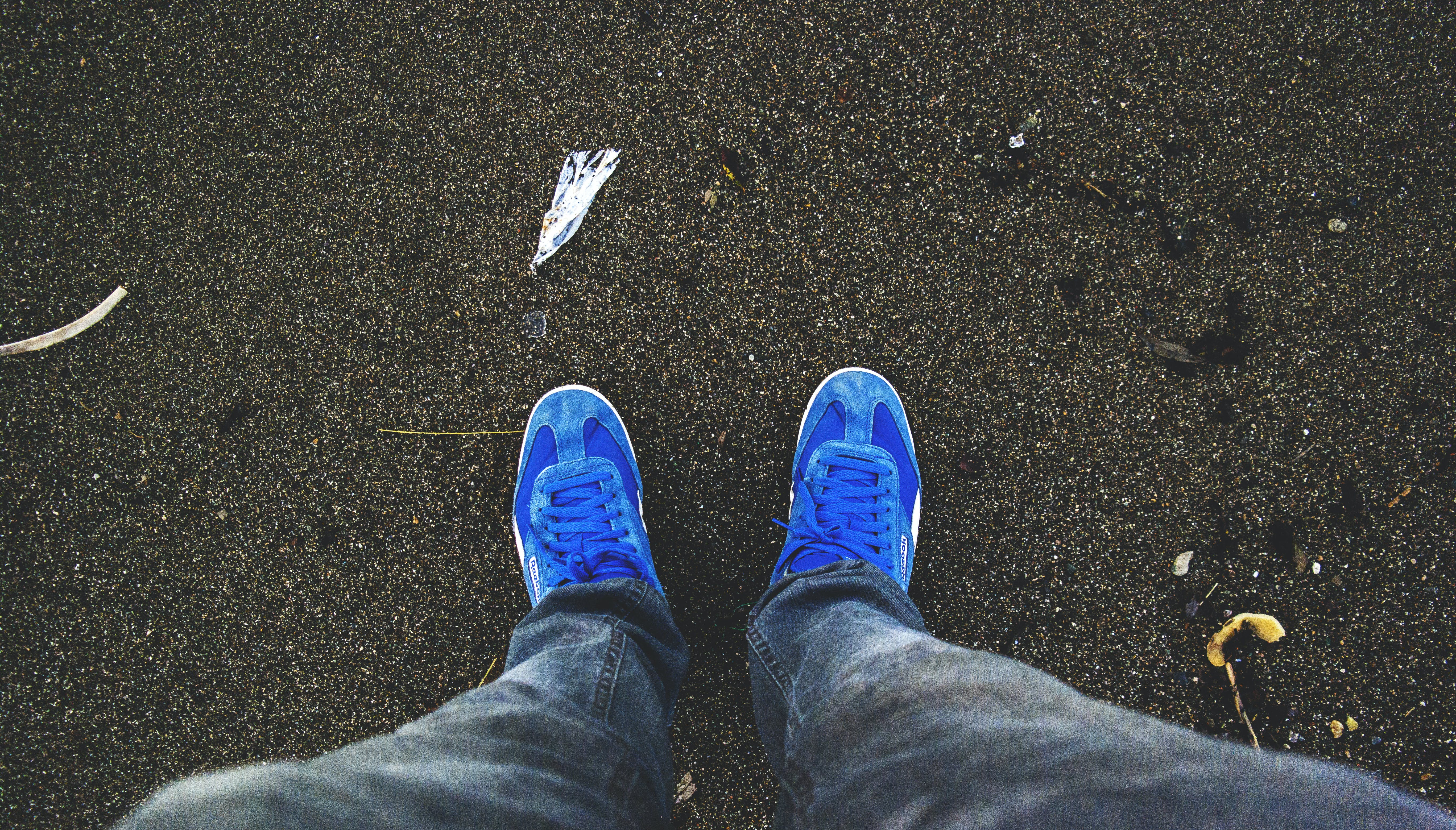 Person Wearing Pair of Blue Sneakers
