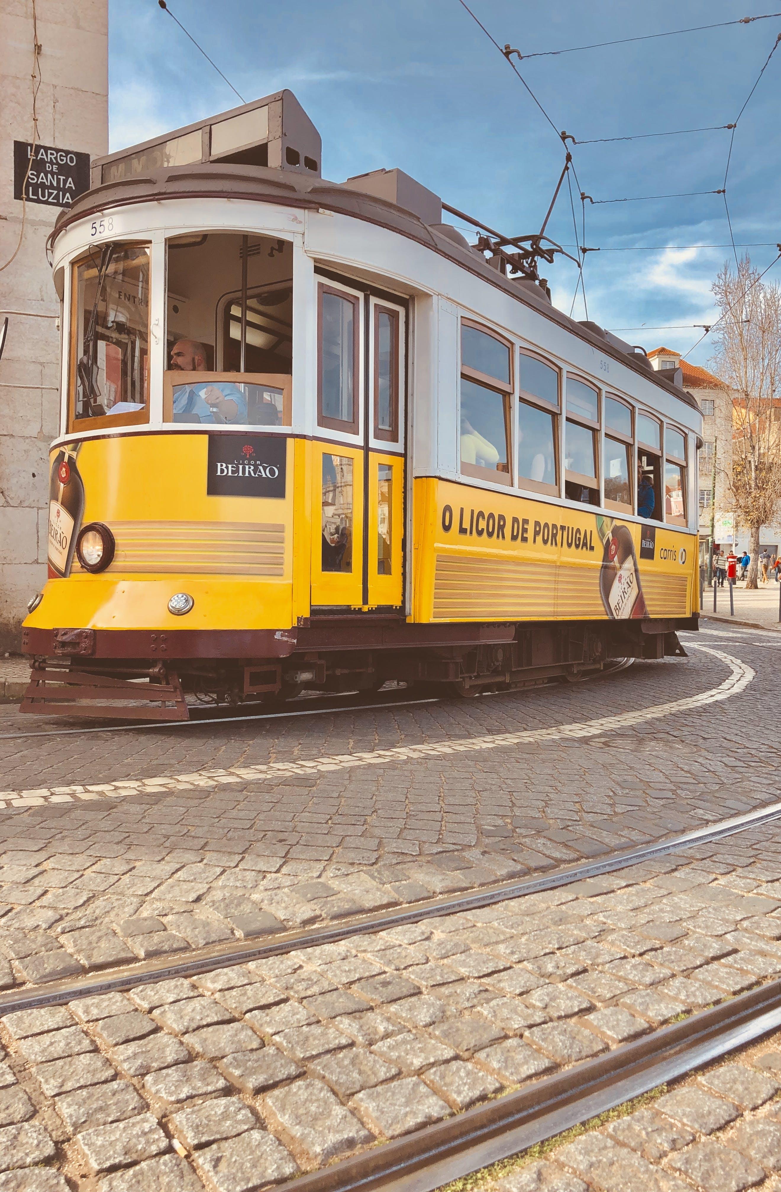 Free stock photo of alfama, Lisbon, tram, yellow