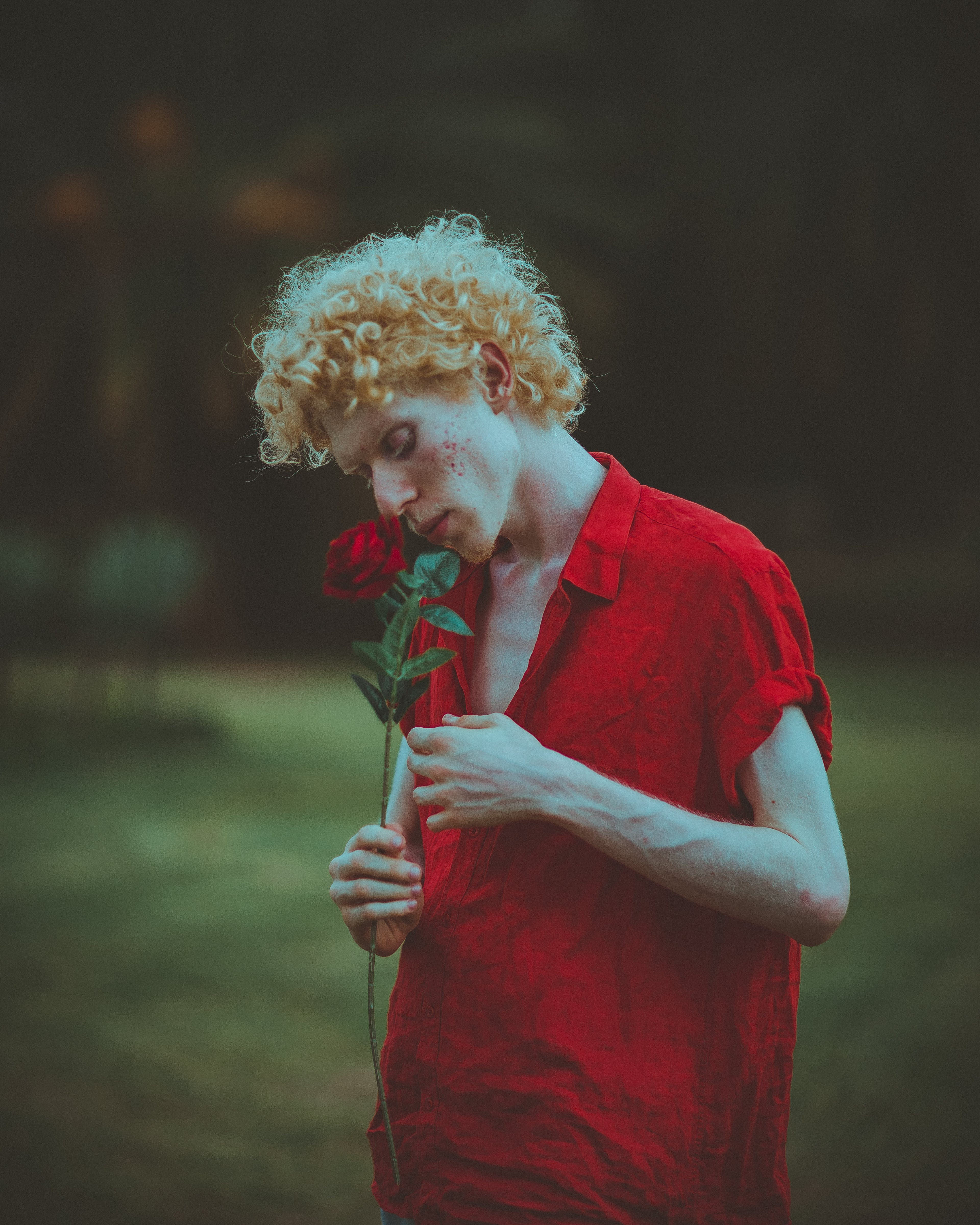 Man Smelling Red Rose
