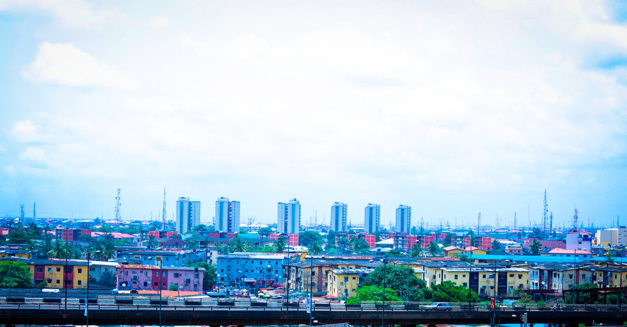 Free stock photo of apartment buildings, cityscape, cloud formation