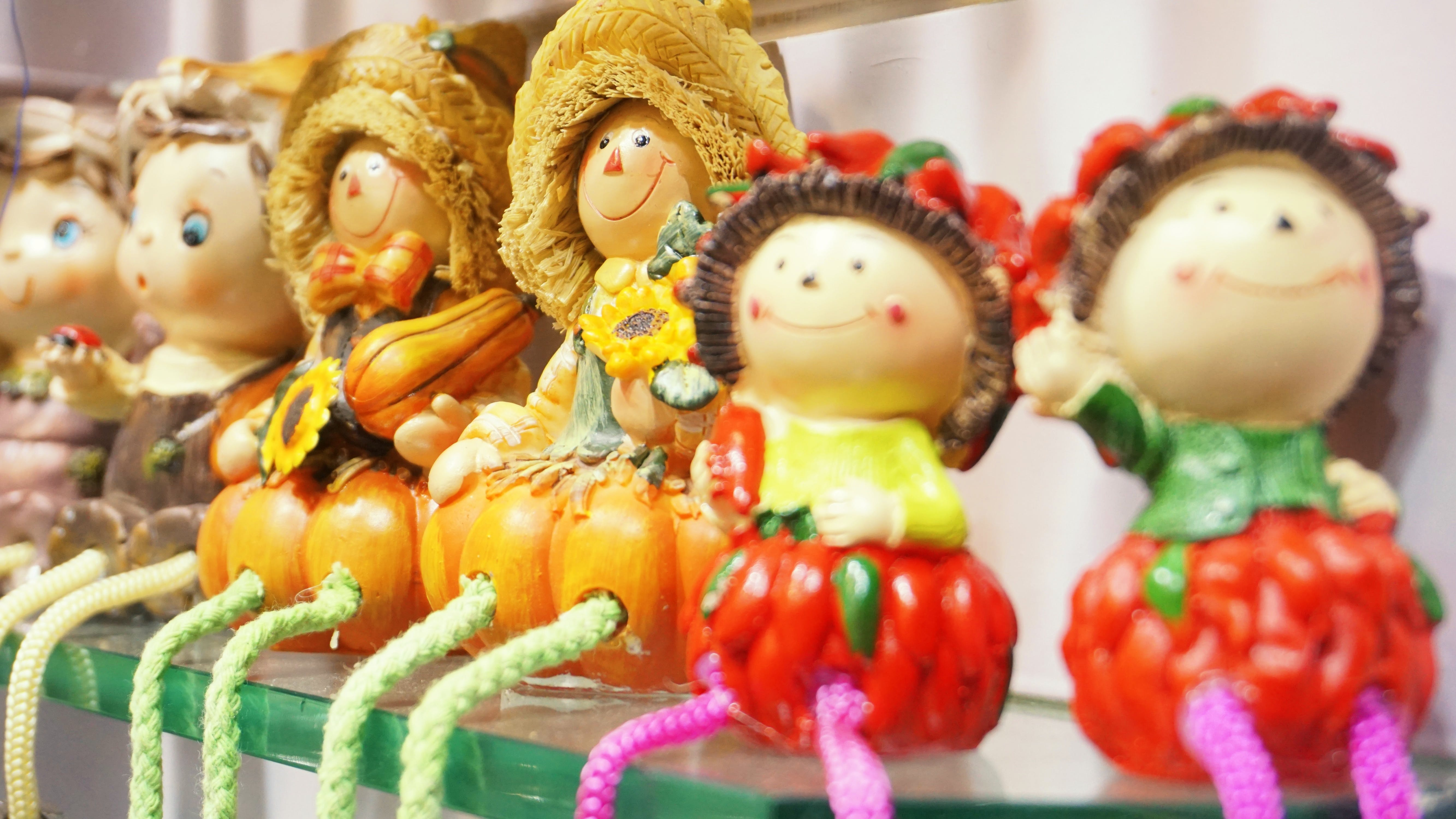 Assorted-design Dolls on Glass Wall Shelf