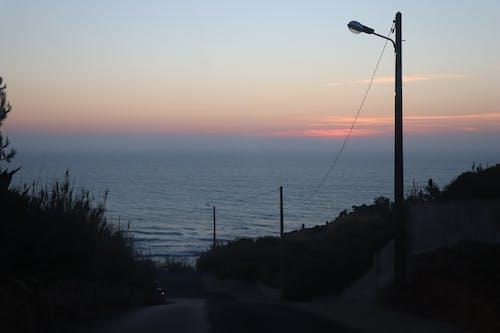 Photos gratuites de bleu, calme, côte, coucher de soleil