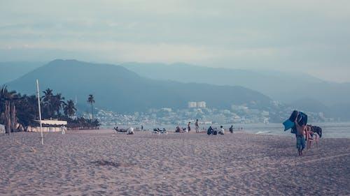 Free stock photo of beach, man, mountains, people