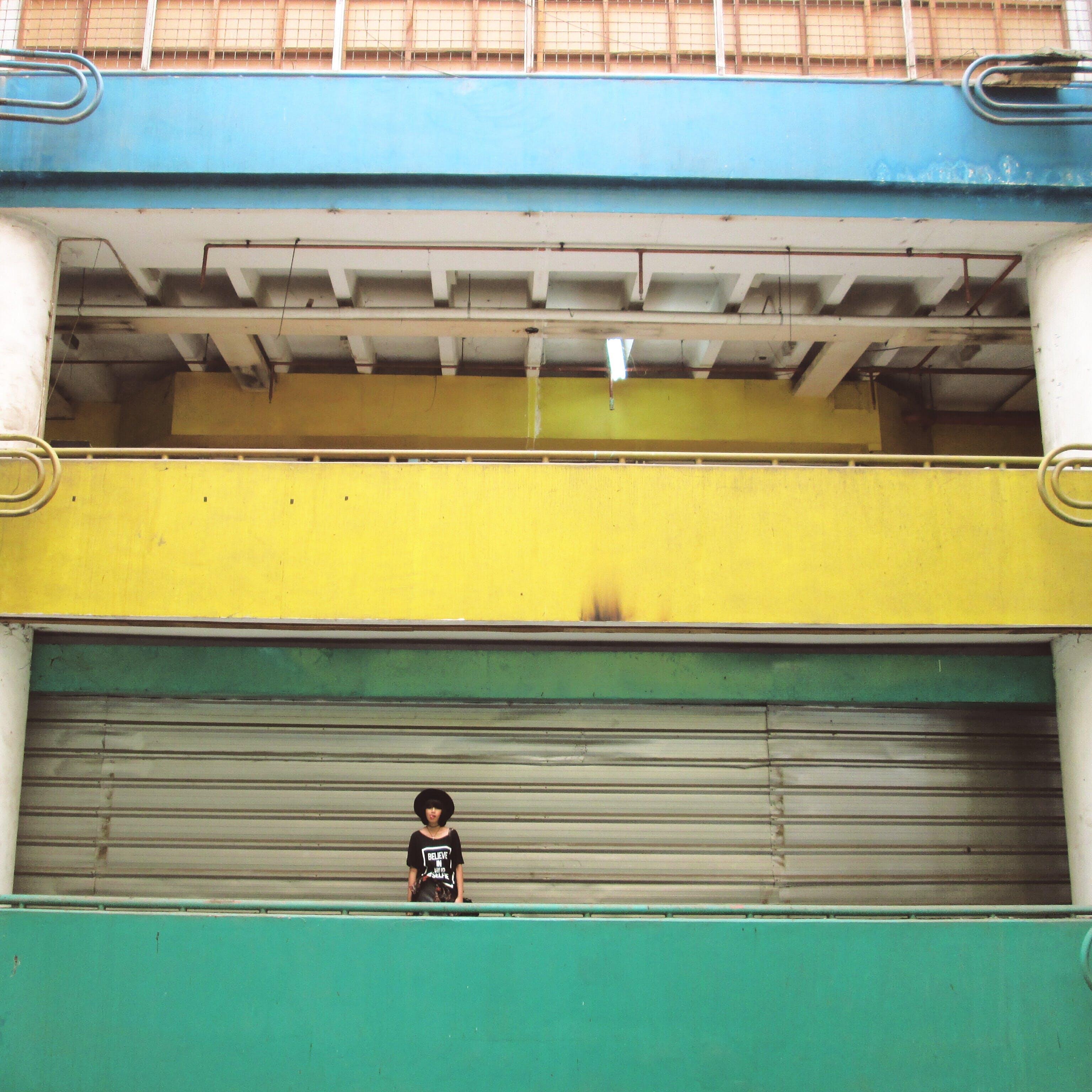 Woman Standing Inside Building