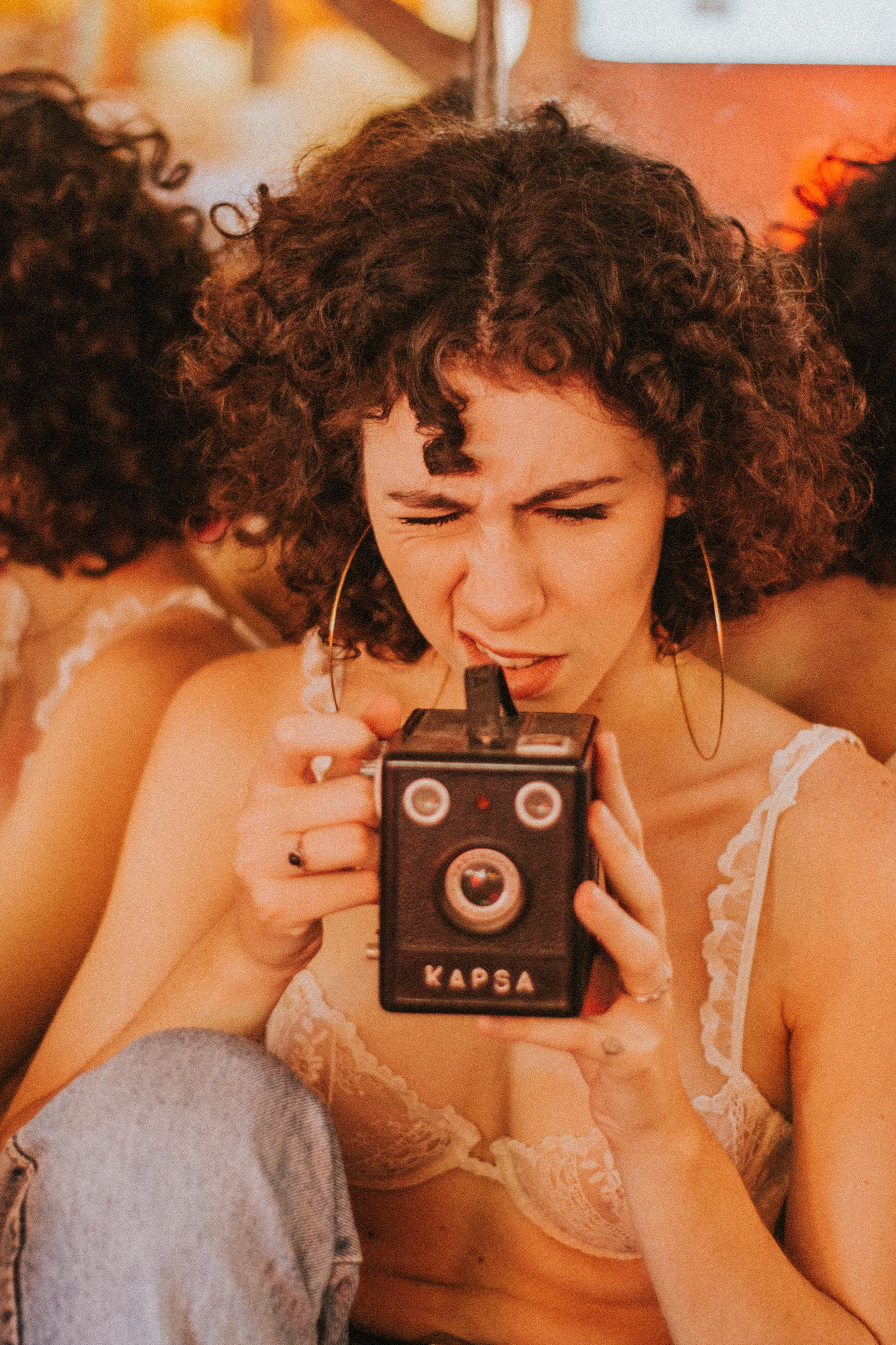Woman Using Black Kapsa Camera