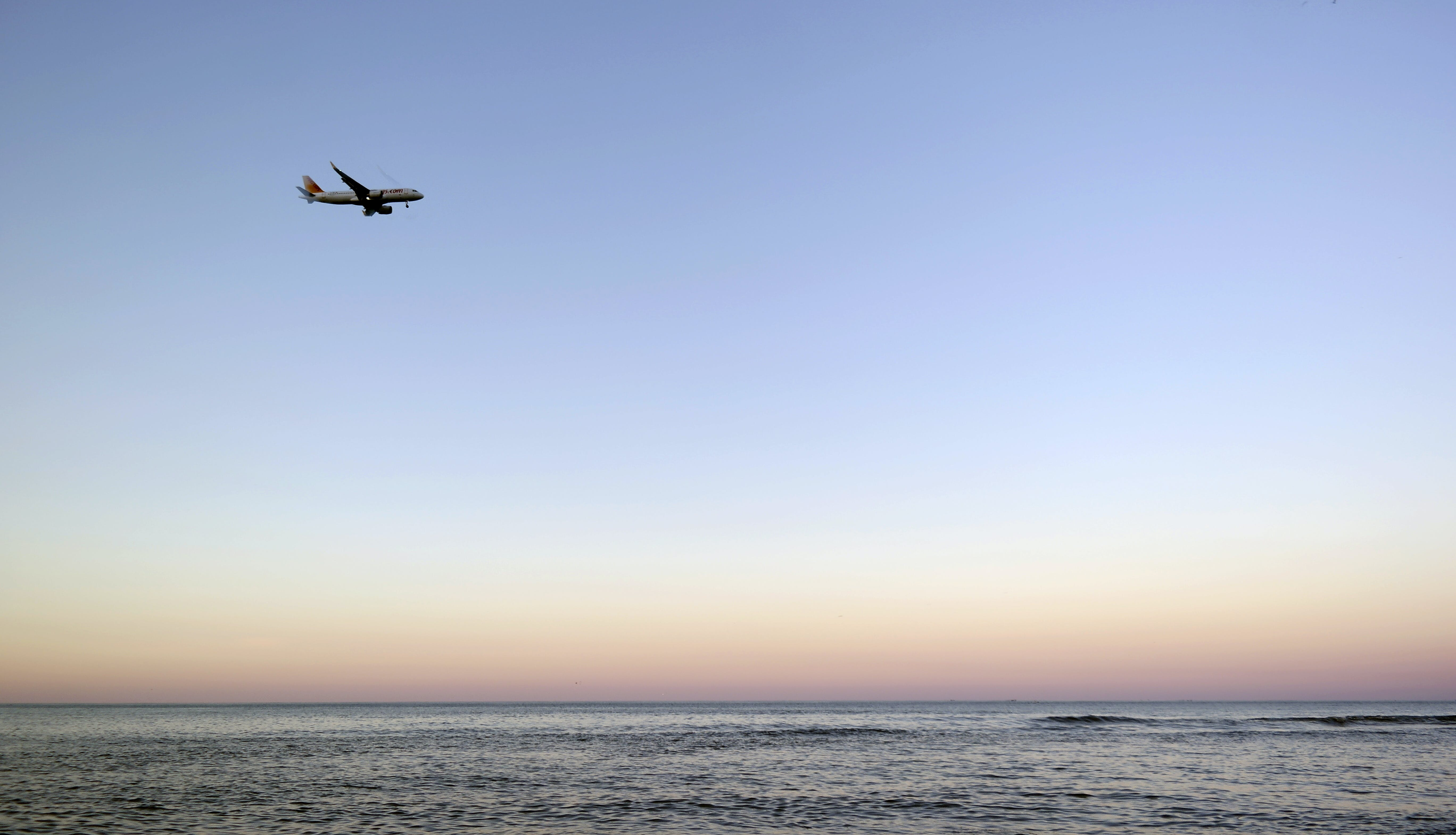 Body of Water and Airliner