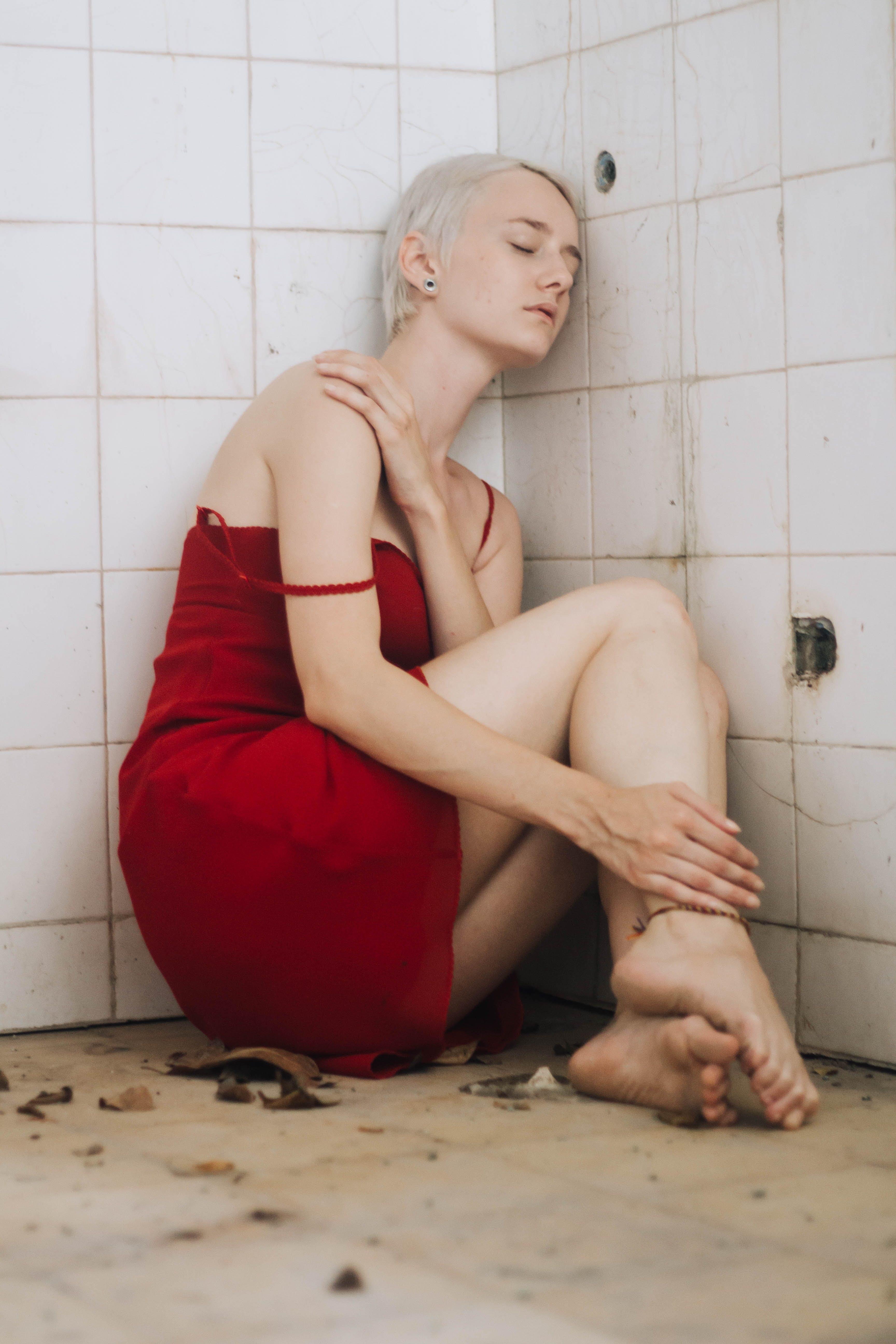 Woman Wearing Red Dress Sitting on Floor