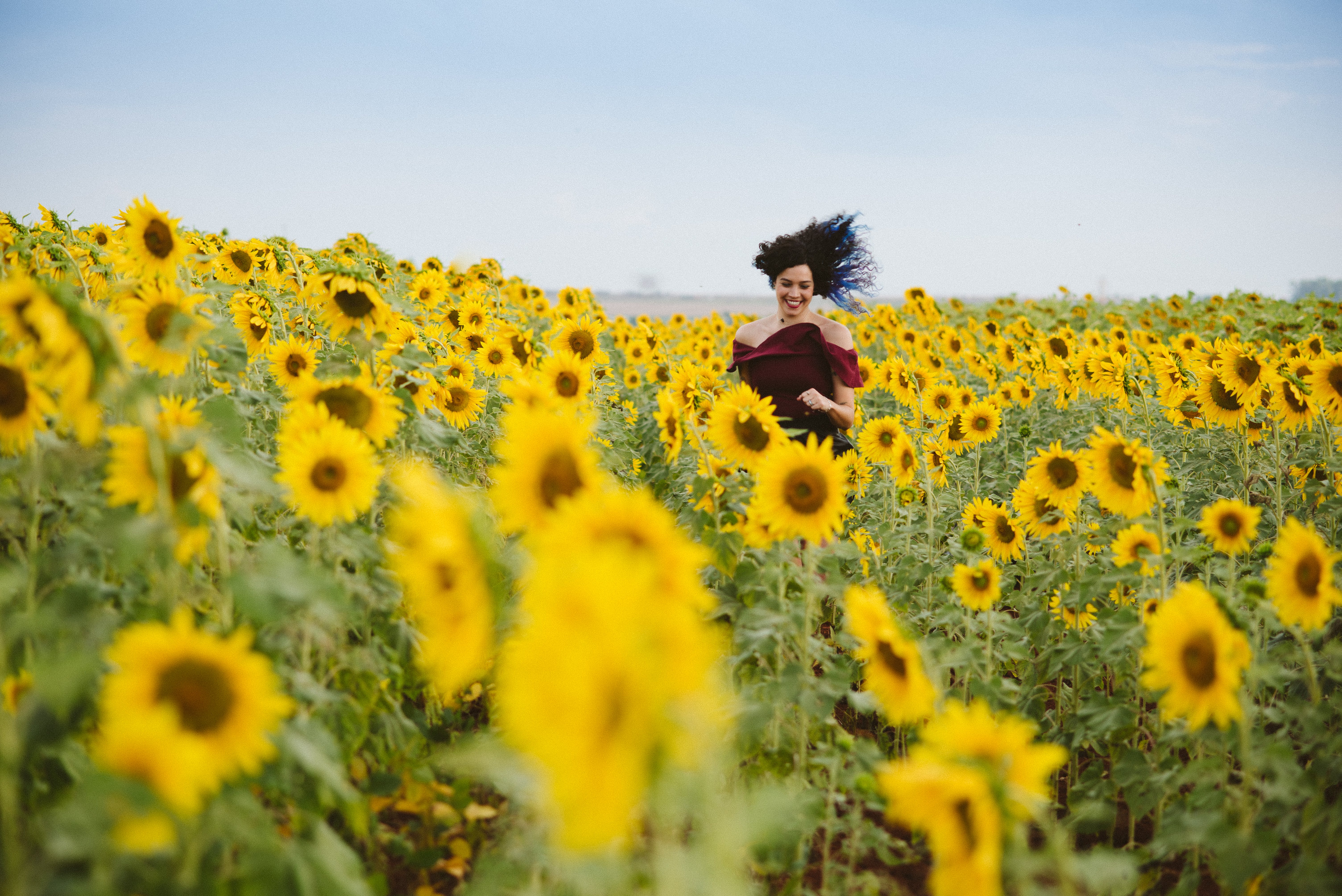Photo of Woman Smiling on Sunflower Field