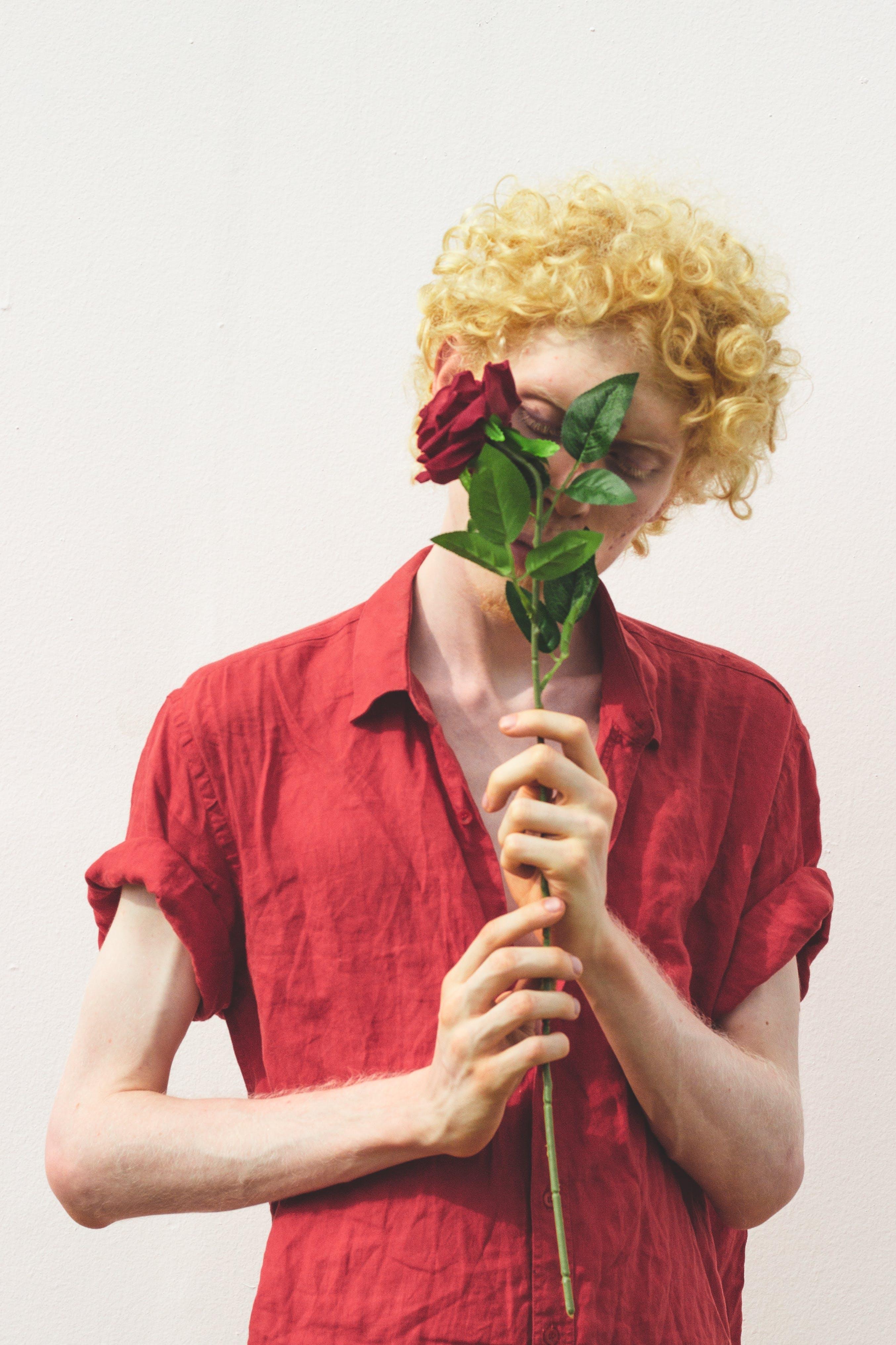 Man Wearing Red Dress Shirt Holding Red Rose