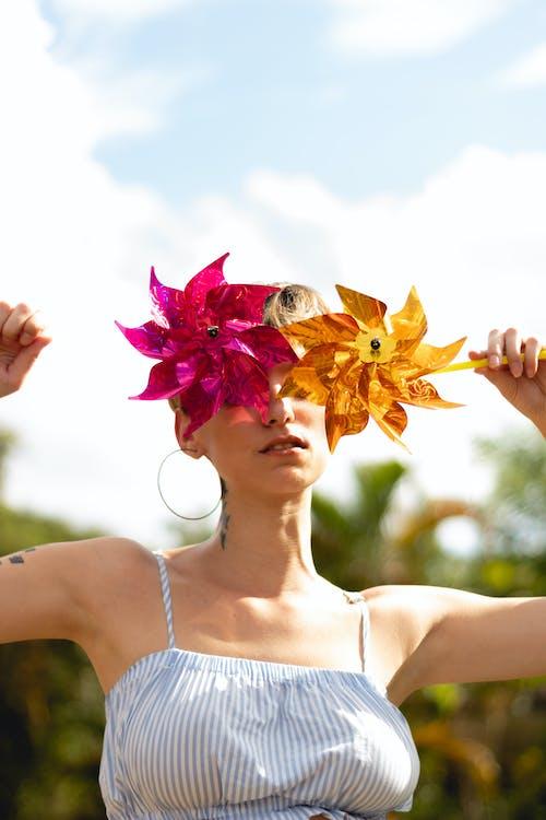 Woman Holding Pinwheels