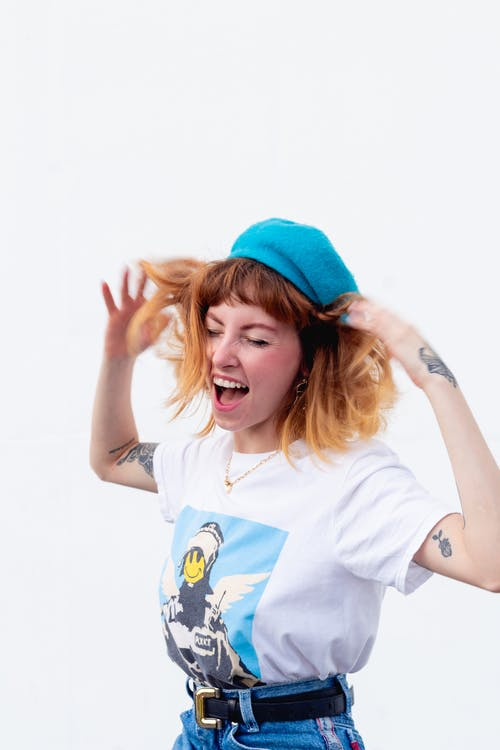 Woman Wearing Shirt and Denim Bottoms