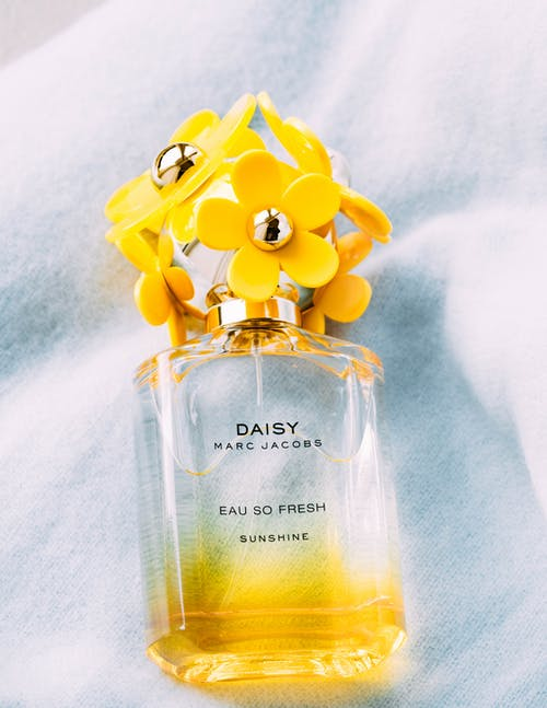 Yellow and White Perfume Bottle