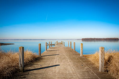 Free stock photo of beach, blue sky, calm waters, dock