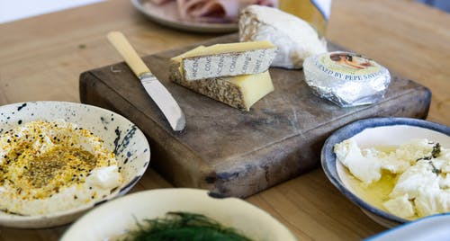 Three Assorted Varieties of Cheese Near Tableknife