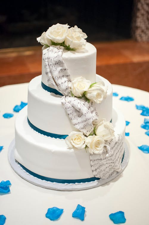 White Rose Flowers On 3 Layer Vanilla Cake