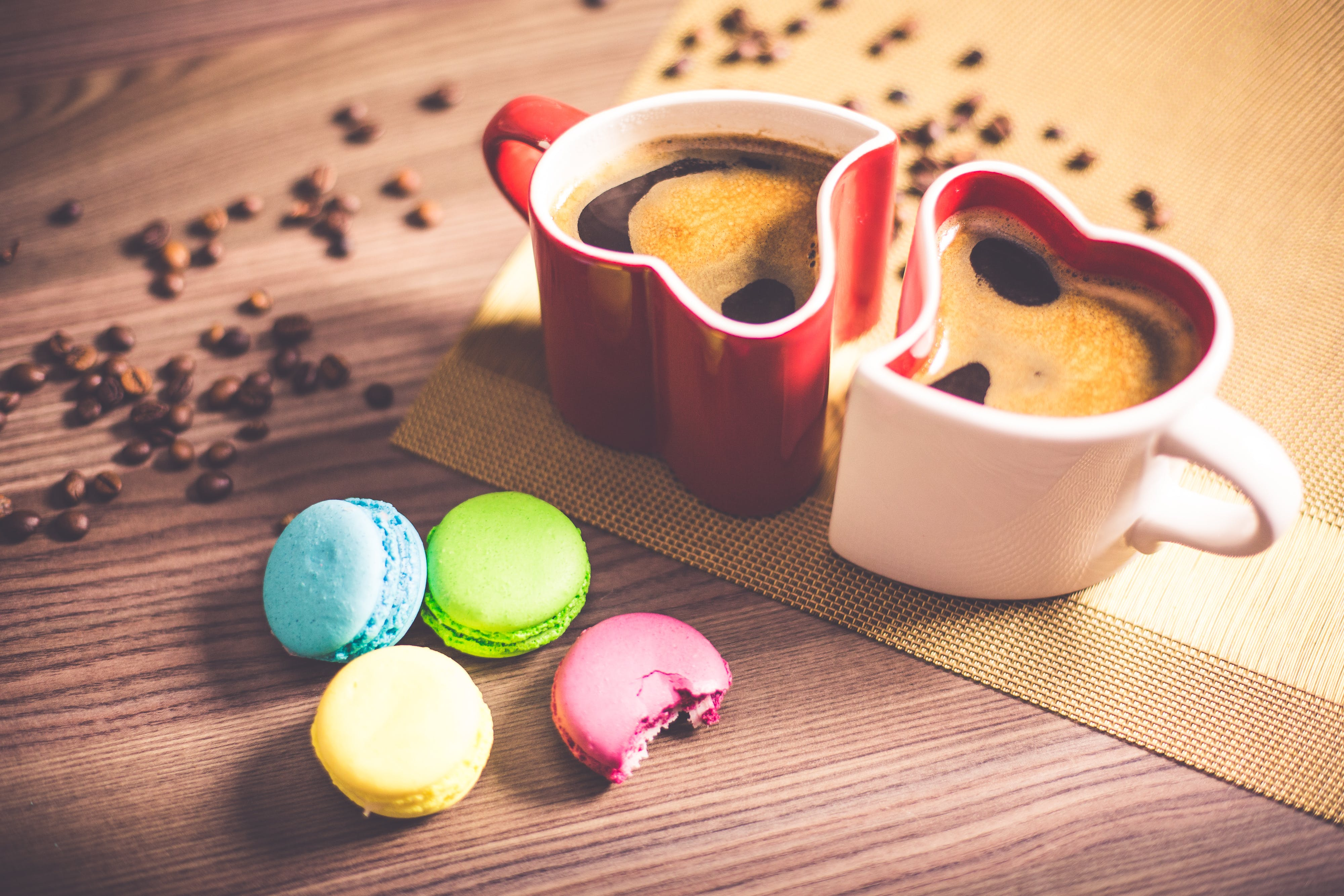 White and Red Couple Heart Mug Filled With Coffee And Macaroons
