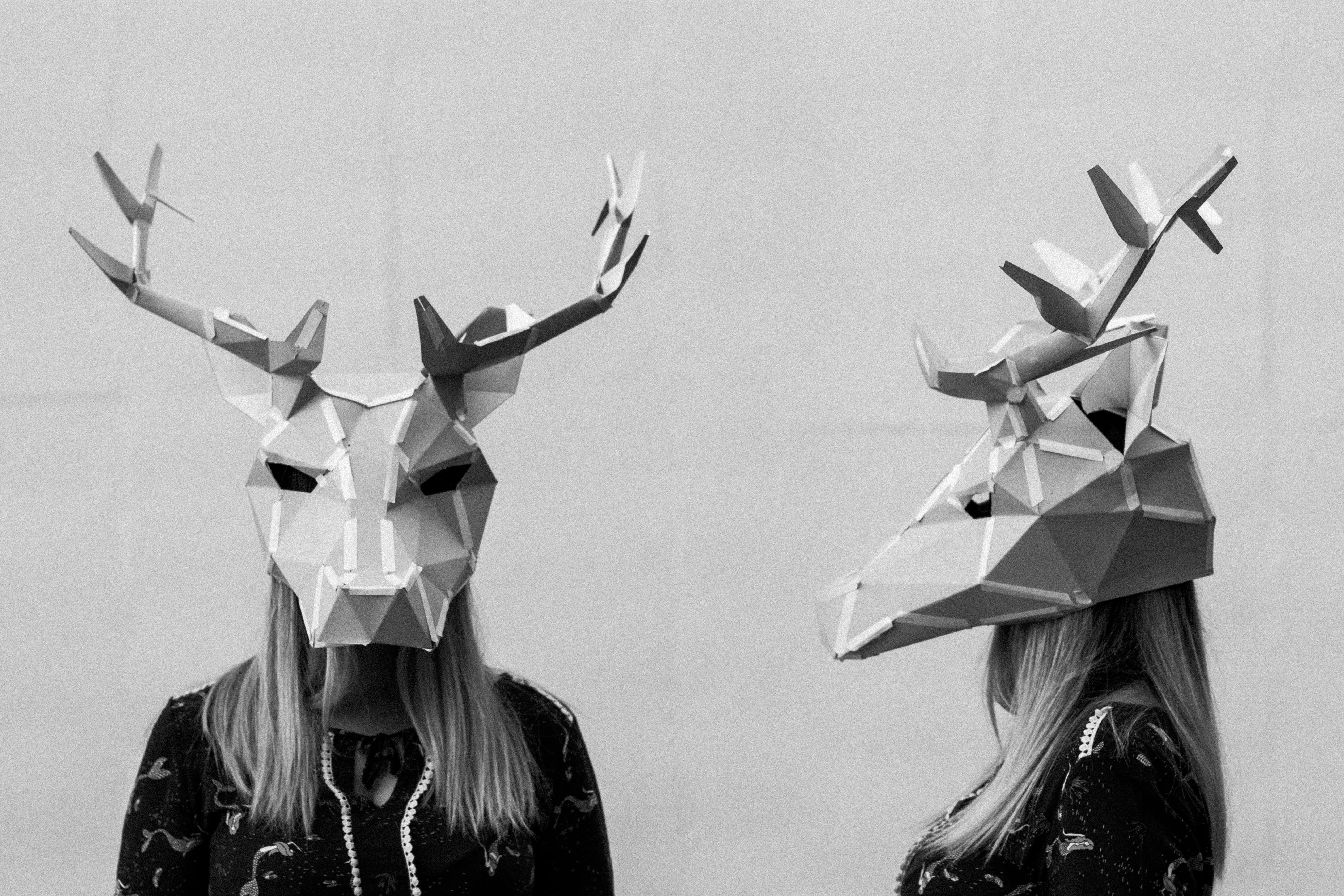 Grayscale Photography Of Person Wearing Deer Mask