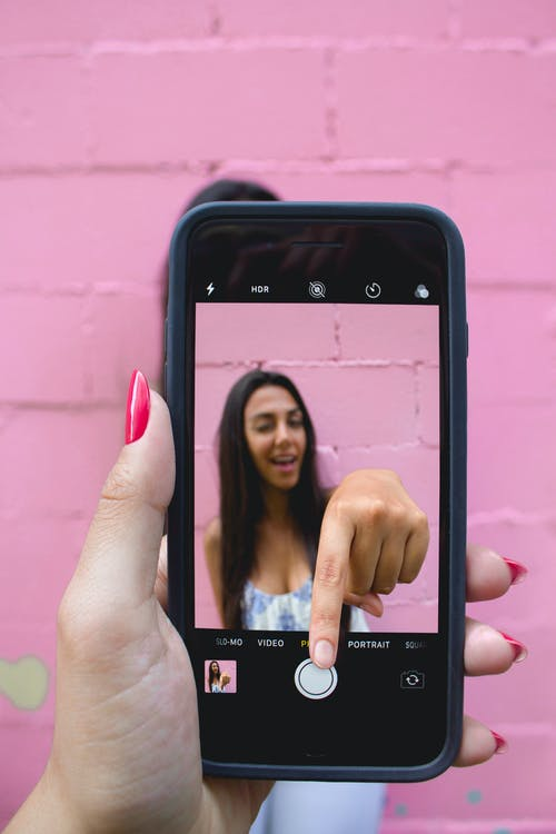 Photo of Person Holding iPhone
