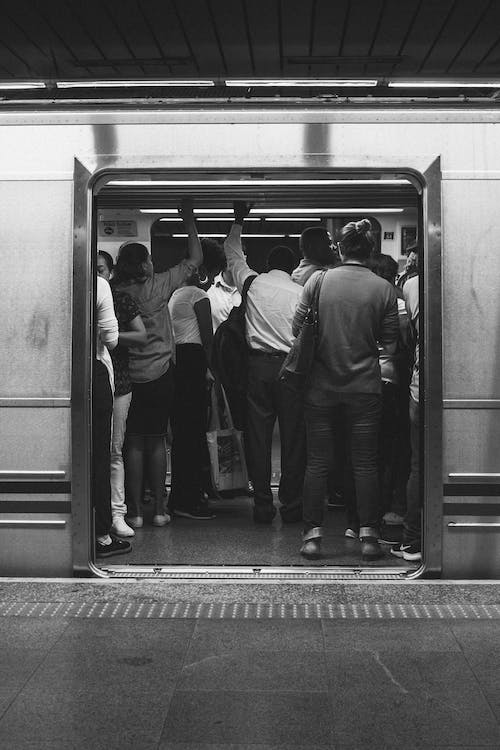 People Standing Inside Train