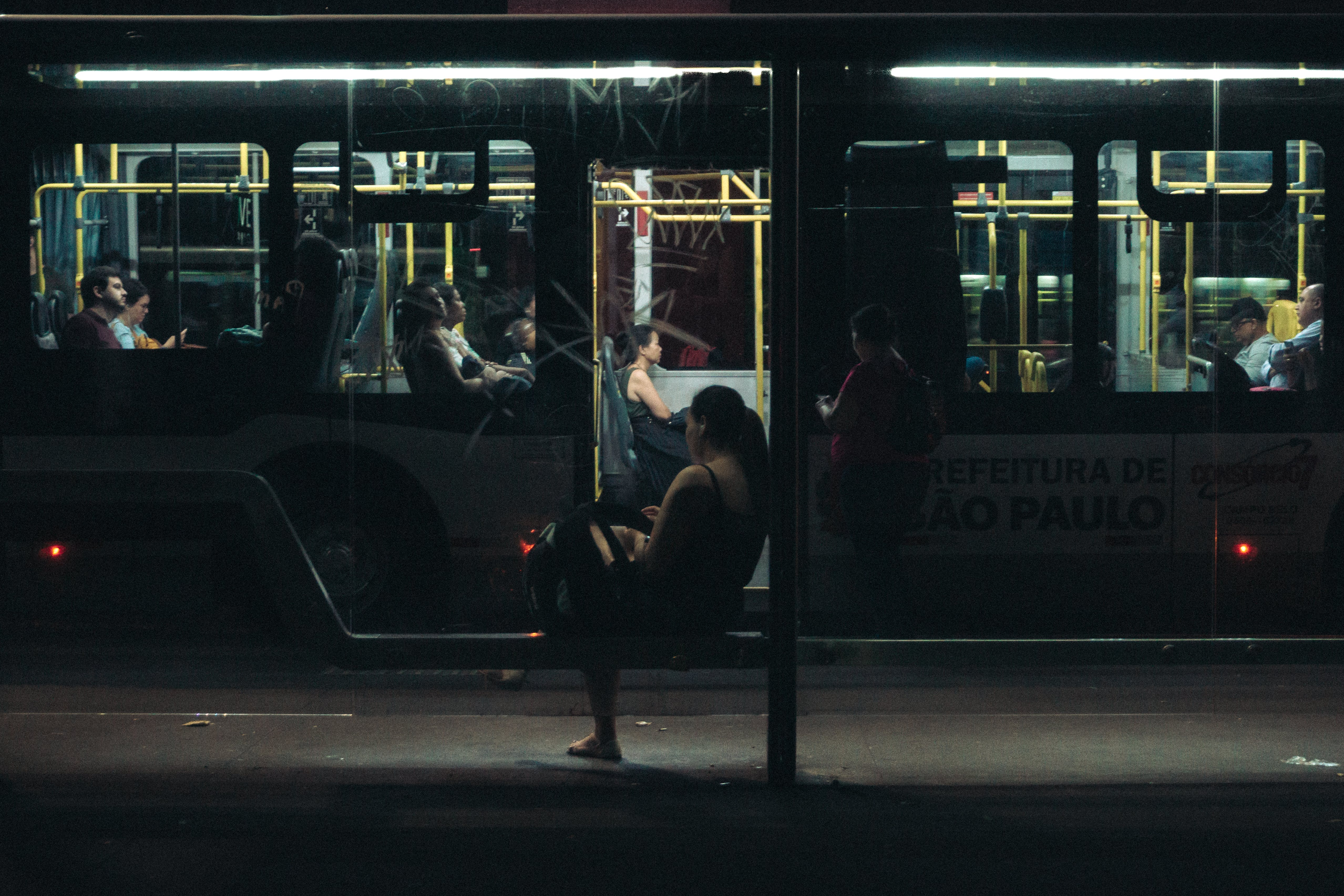 Woman Sitting on Bench during Nighttime
