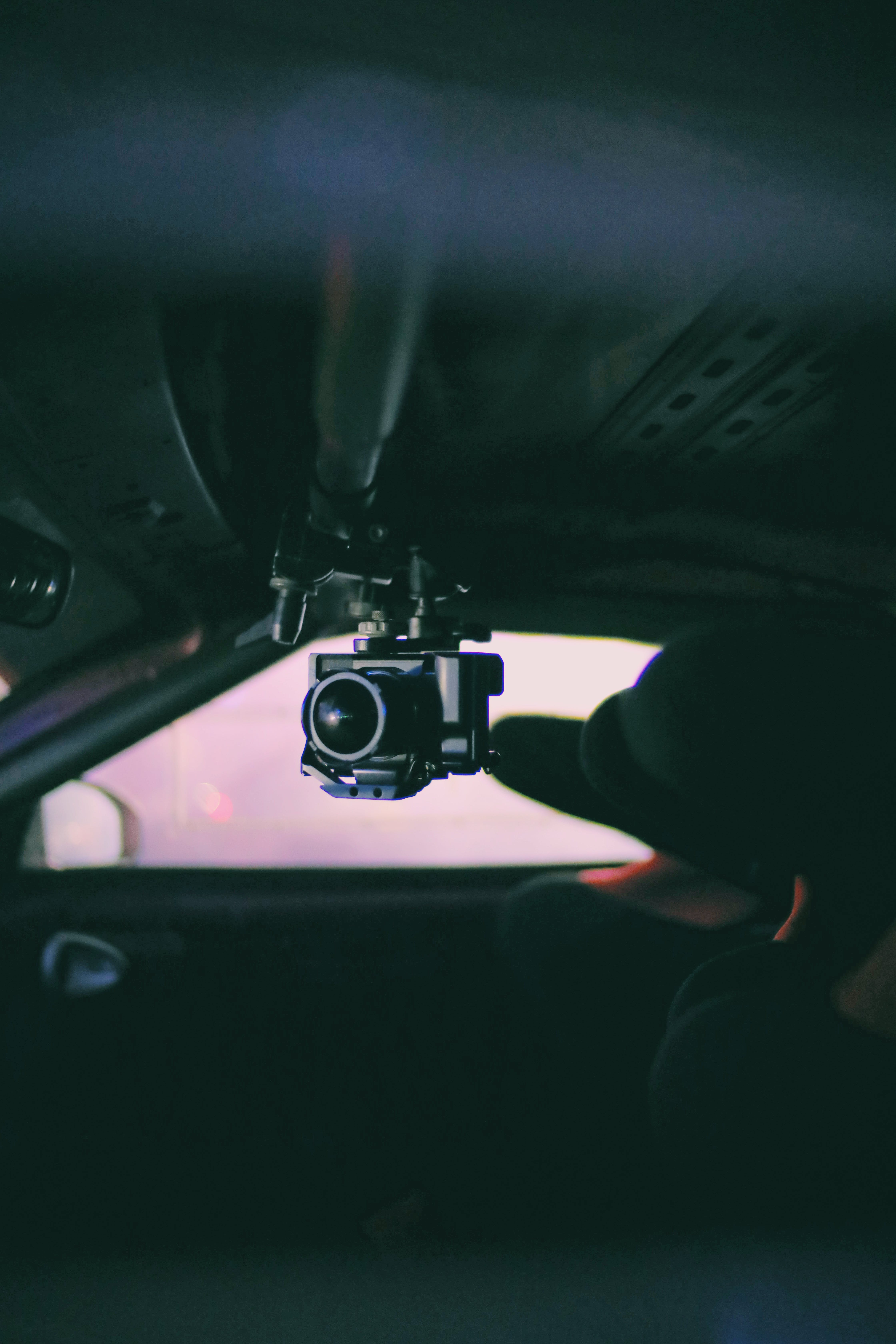 Selective Focus Photo of of Black Camera Inside Vehicle