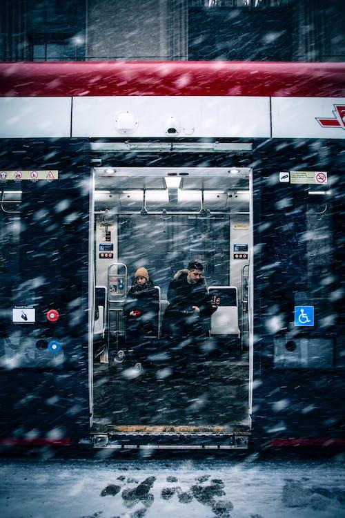 Man Beside Woman in Train