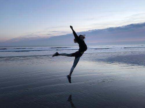 Free stock photo of beach, girl, jump, sunset