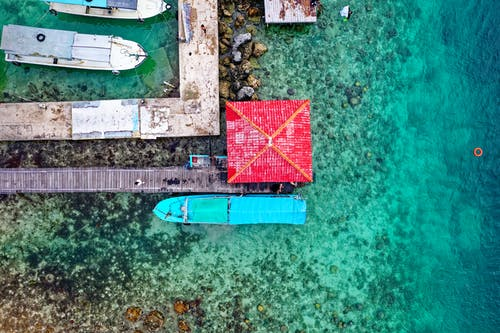 Aerial Photography Of Boats On Body Of Water