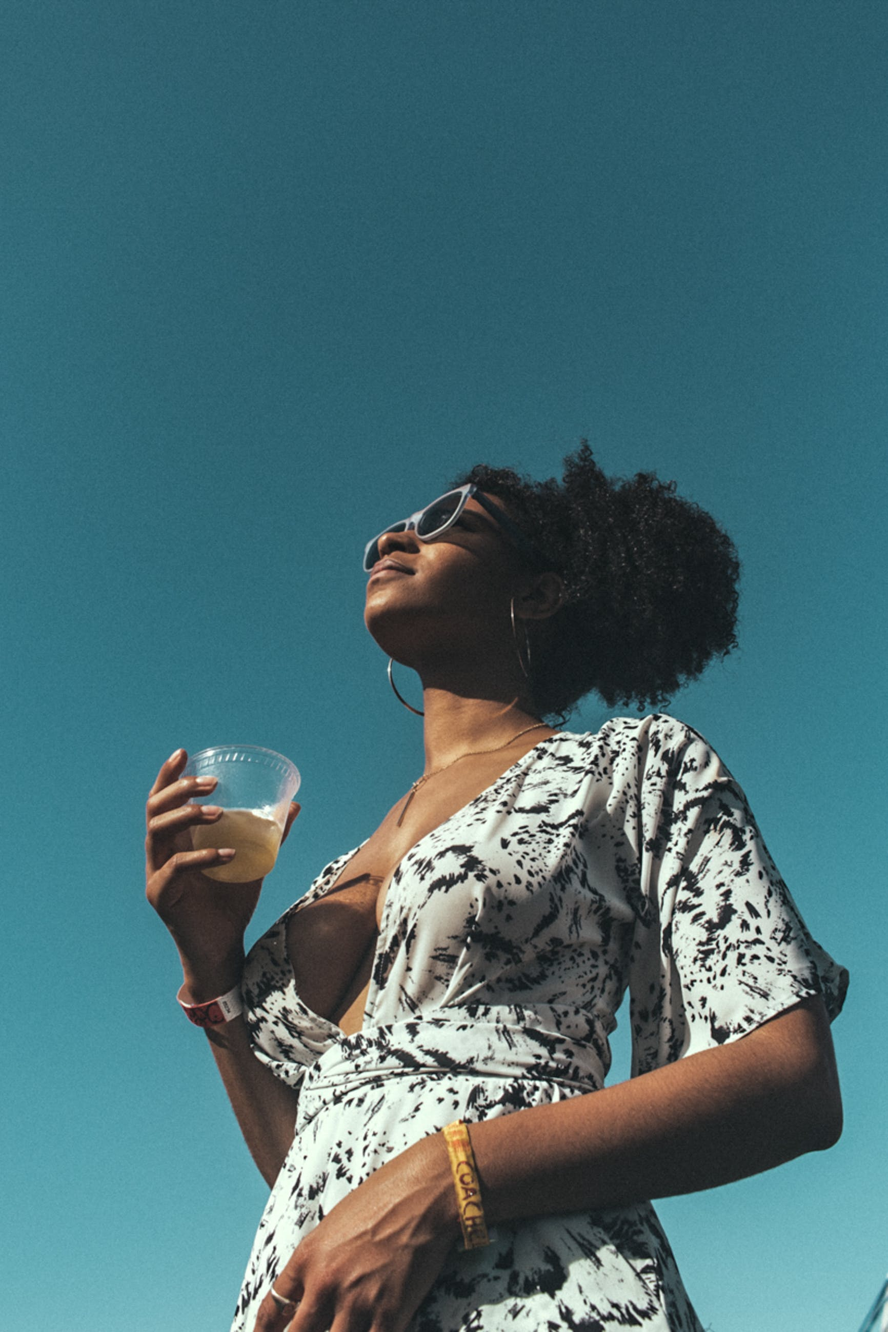 Woman Holding Drinking Glass Outdoor