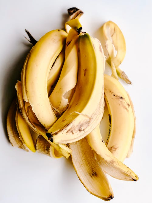 Yellow Banana Peels on White Surface