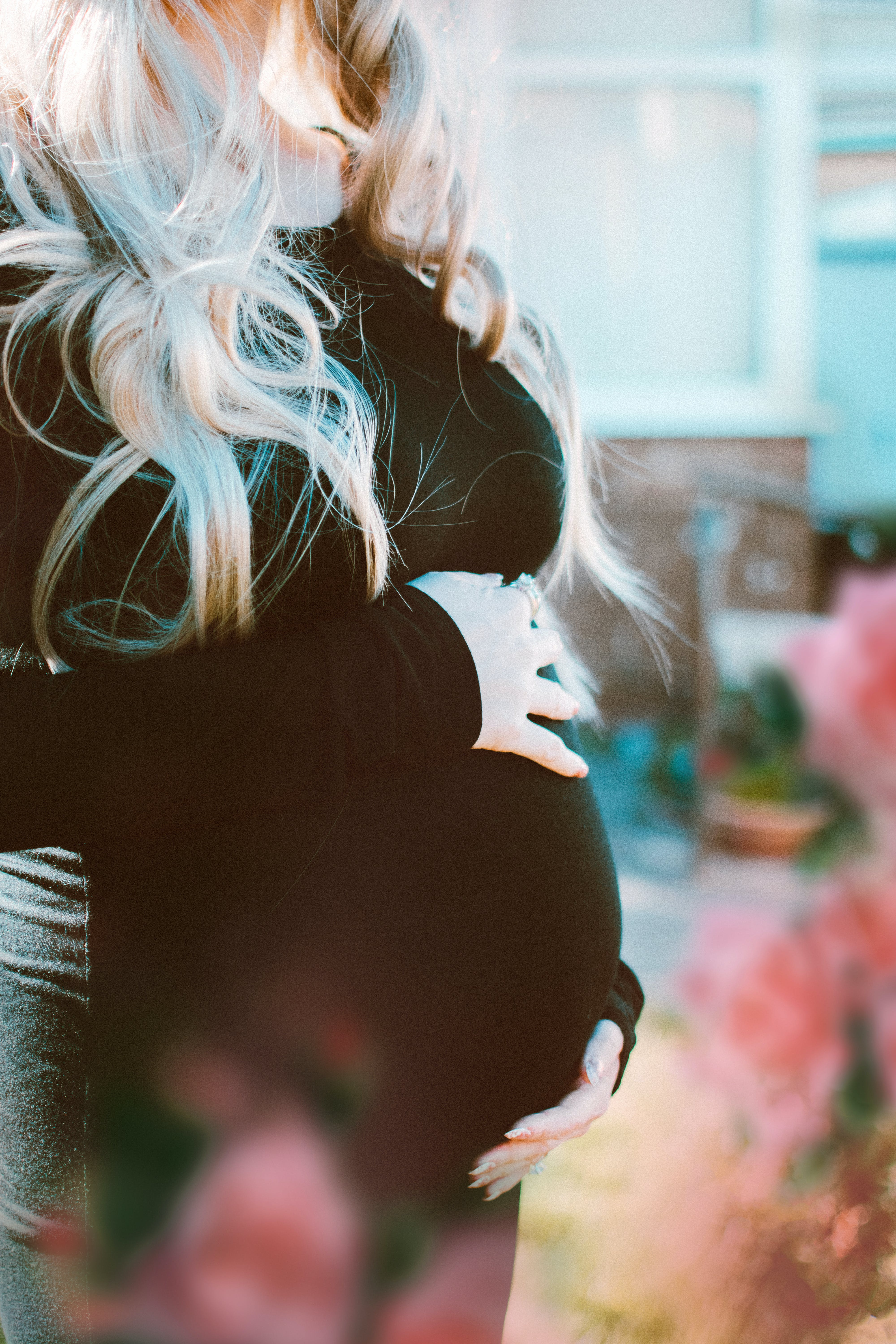 Pregnant Woman In Black Long-sleeved Dress