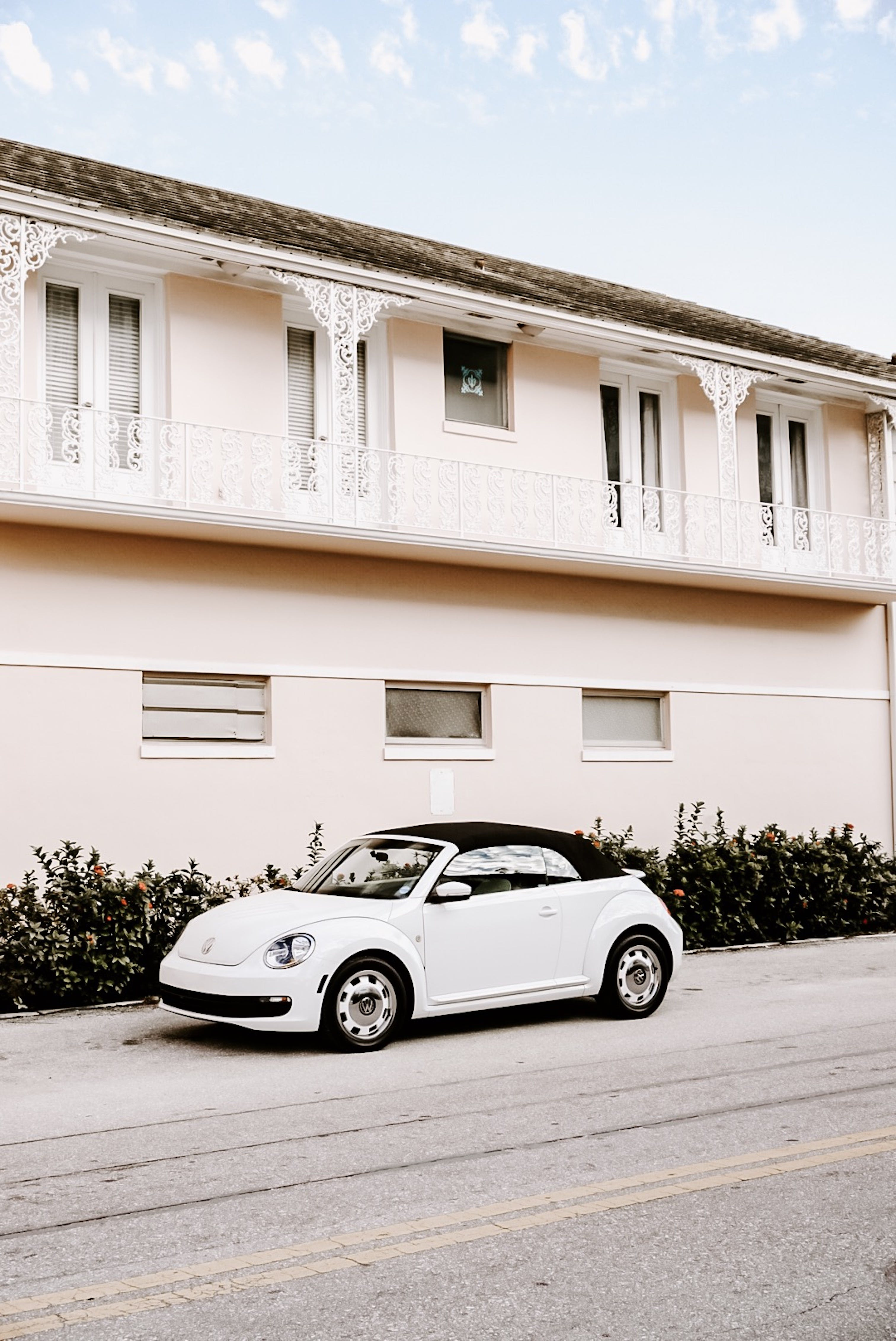 White Convertible Coupe Parked Beside House