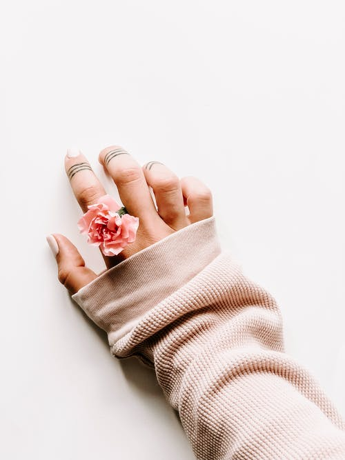 Woman With Pink Fabric Rose Ring