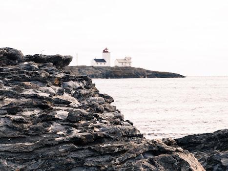 Gray Rock and House Near the Sea