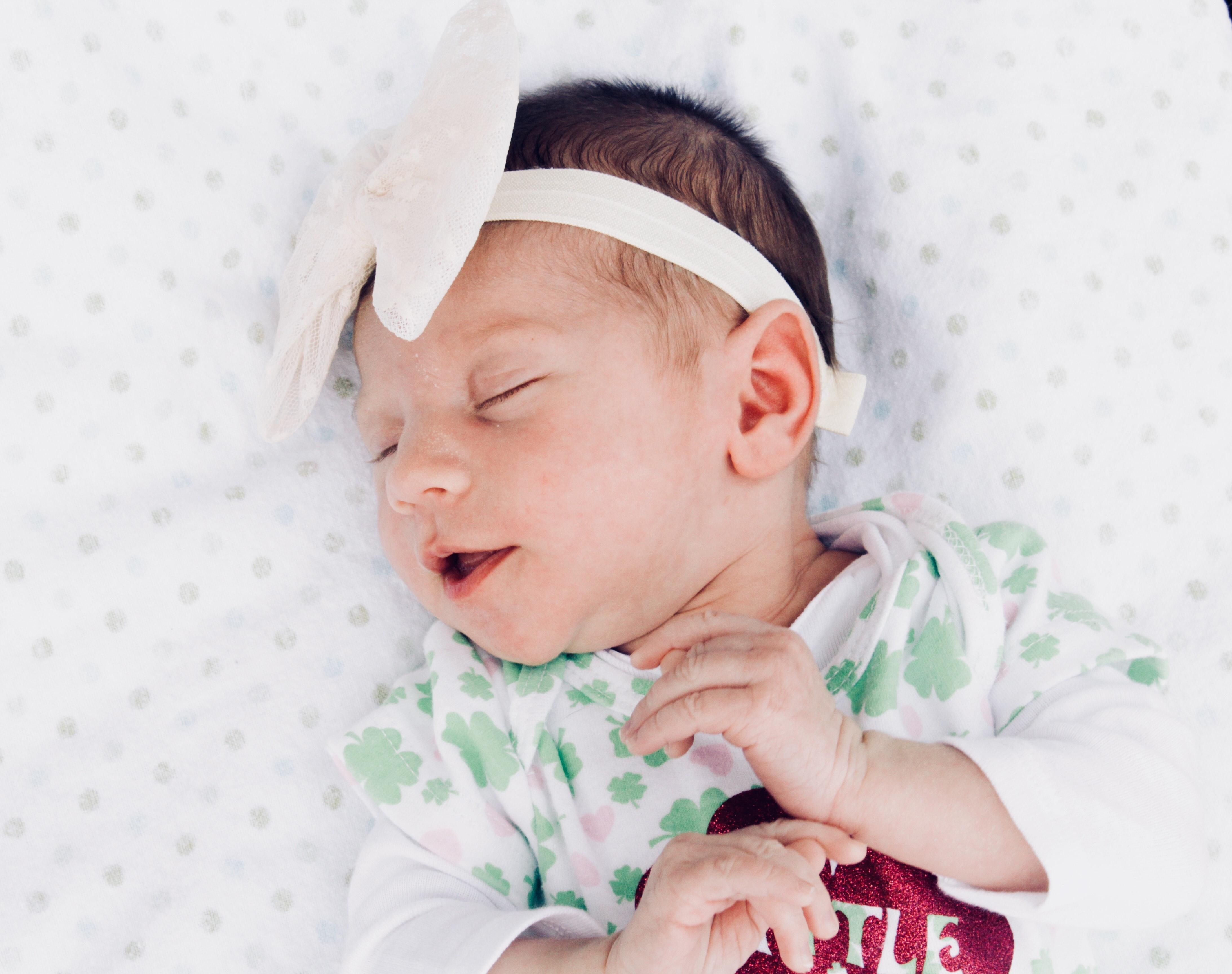 Adorable Newborn Baby Sleeping On Bed Free Stock Photo