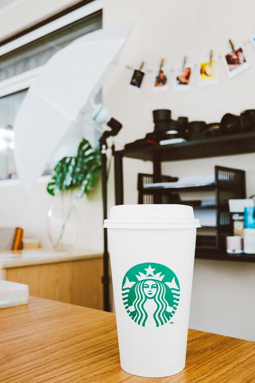 White Starbucks Disposable Cup On Brown Table