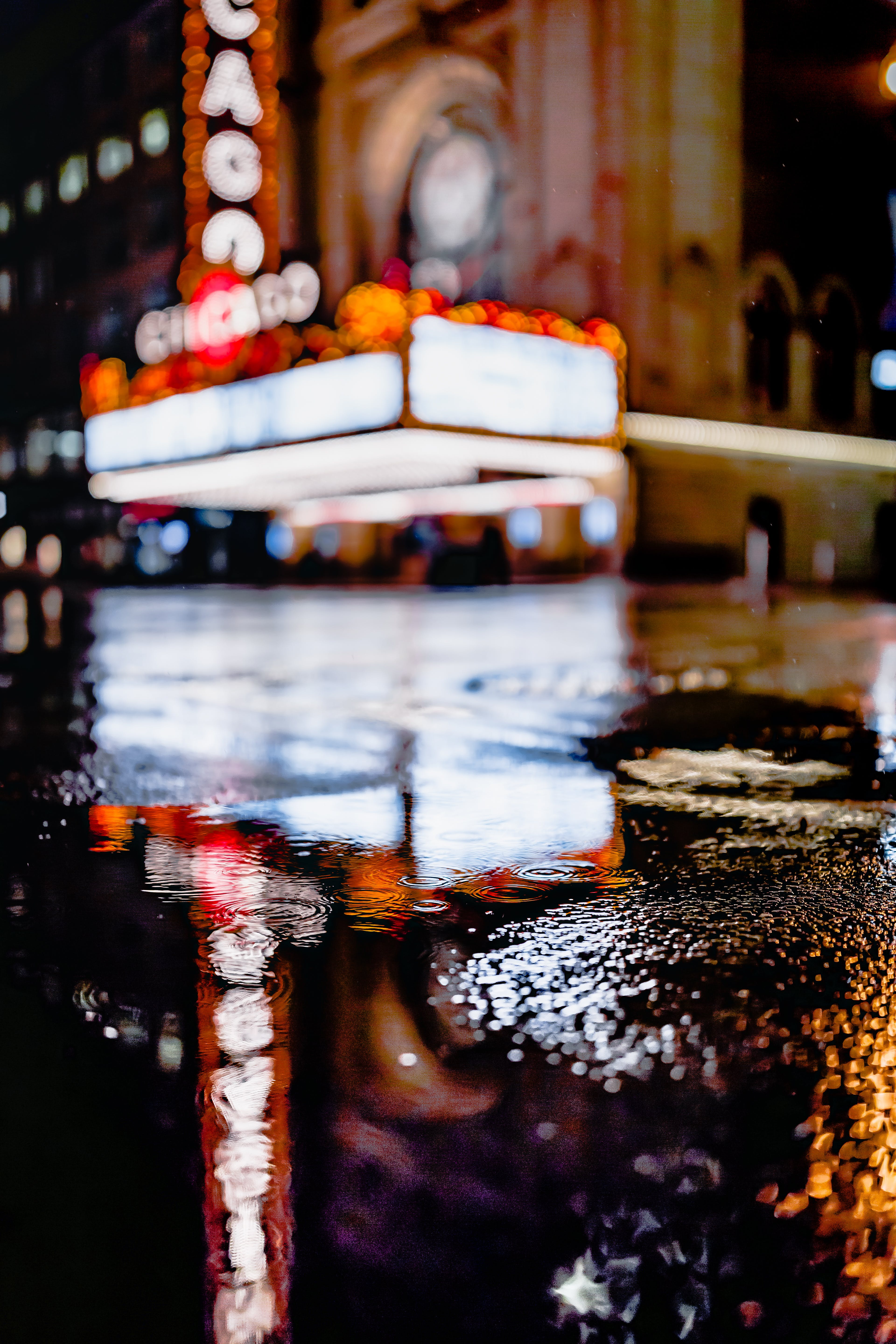 Selective Focus Photography of Puddle on Roadway