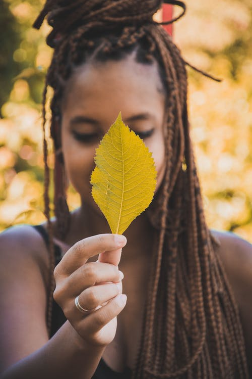 Woman Holding Leaf