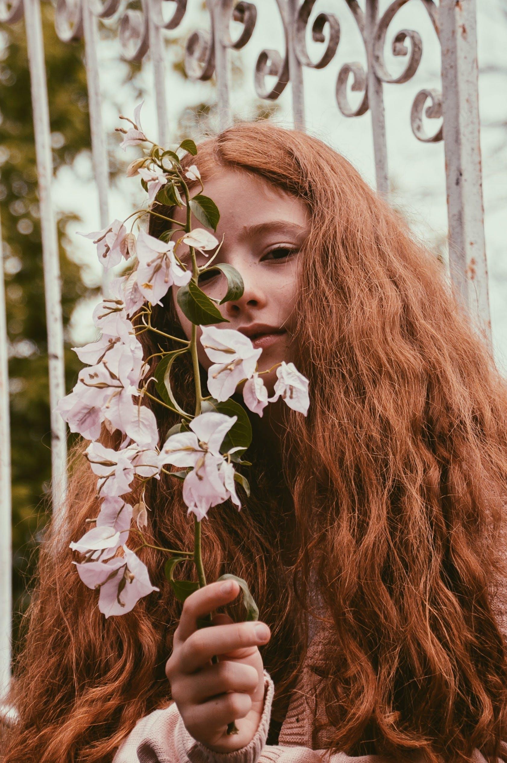 Girl Holding White-petaled Flowers