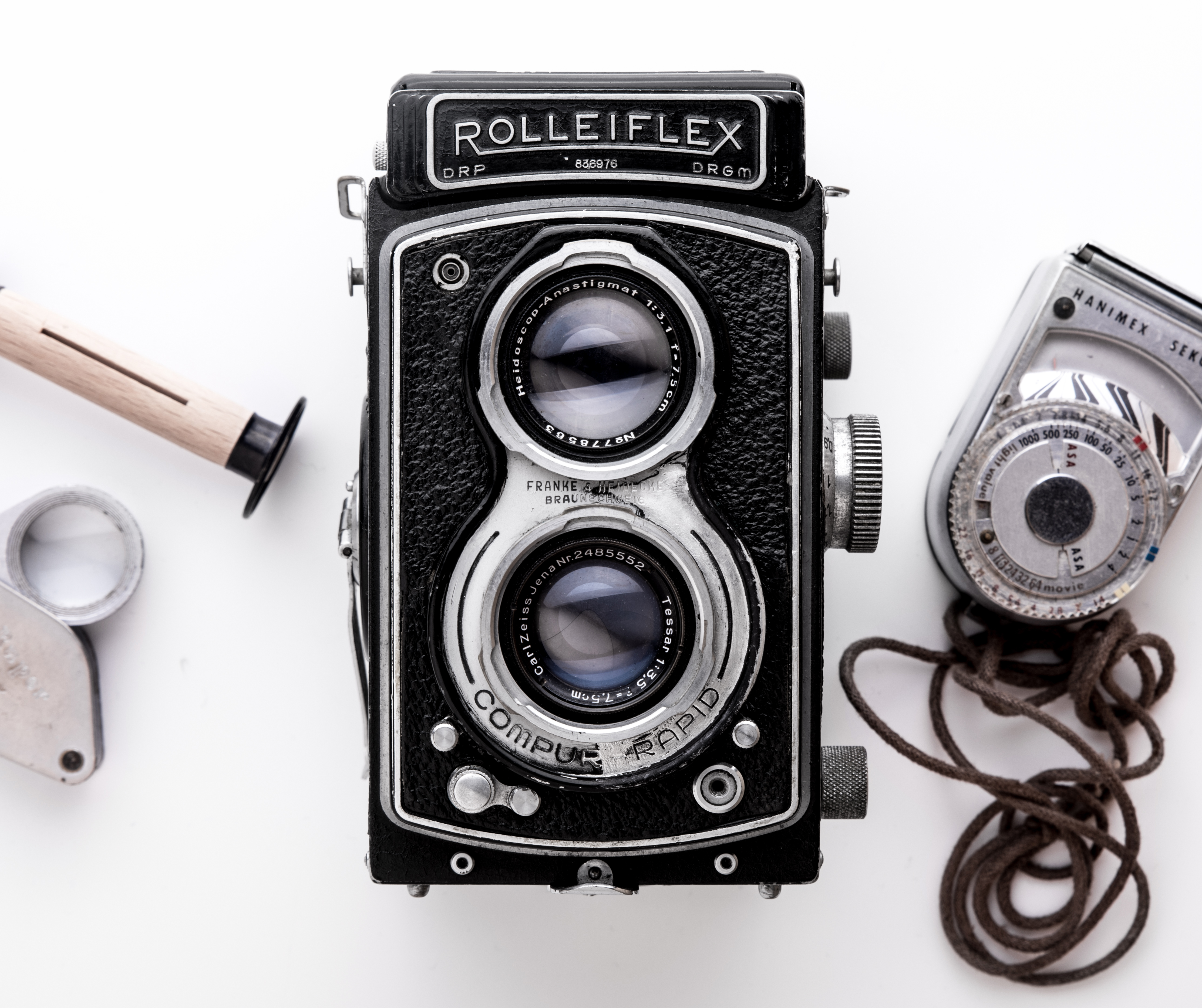 Black Rolleiflex Camera on White Surface