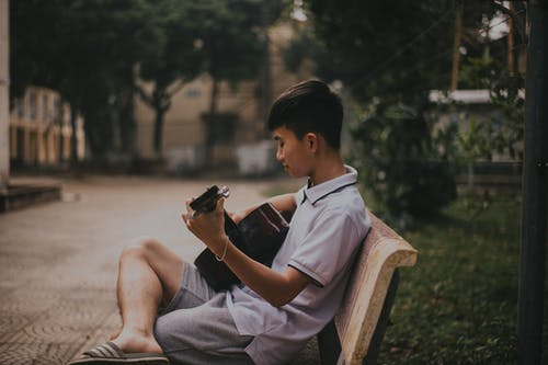 Photo of Boy Playing Guitar