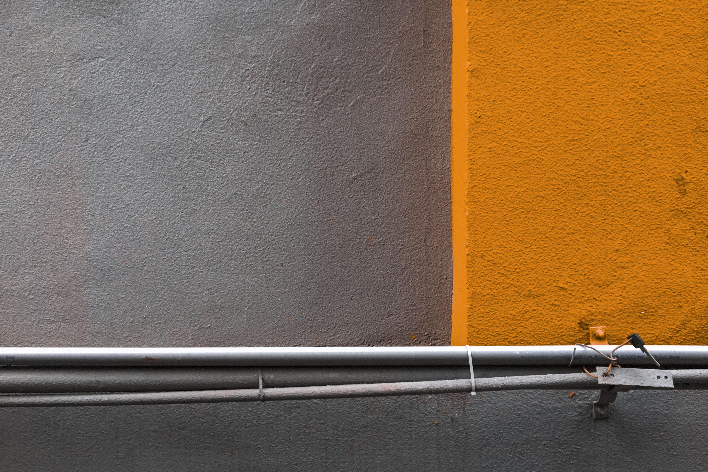 Gray Metal Pipe Beside Wall