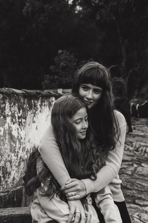 Woman Beside Girl