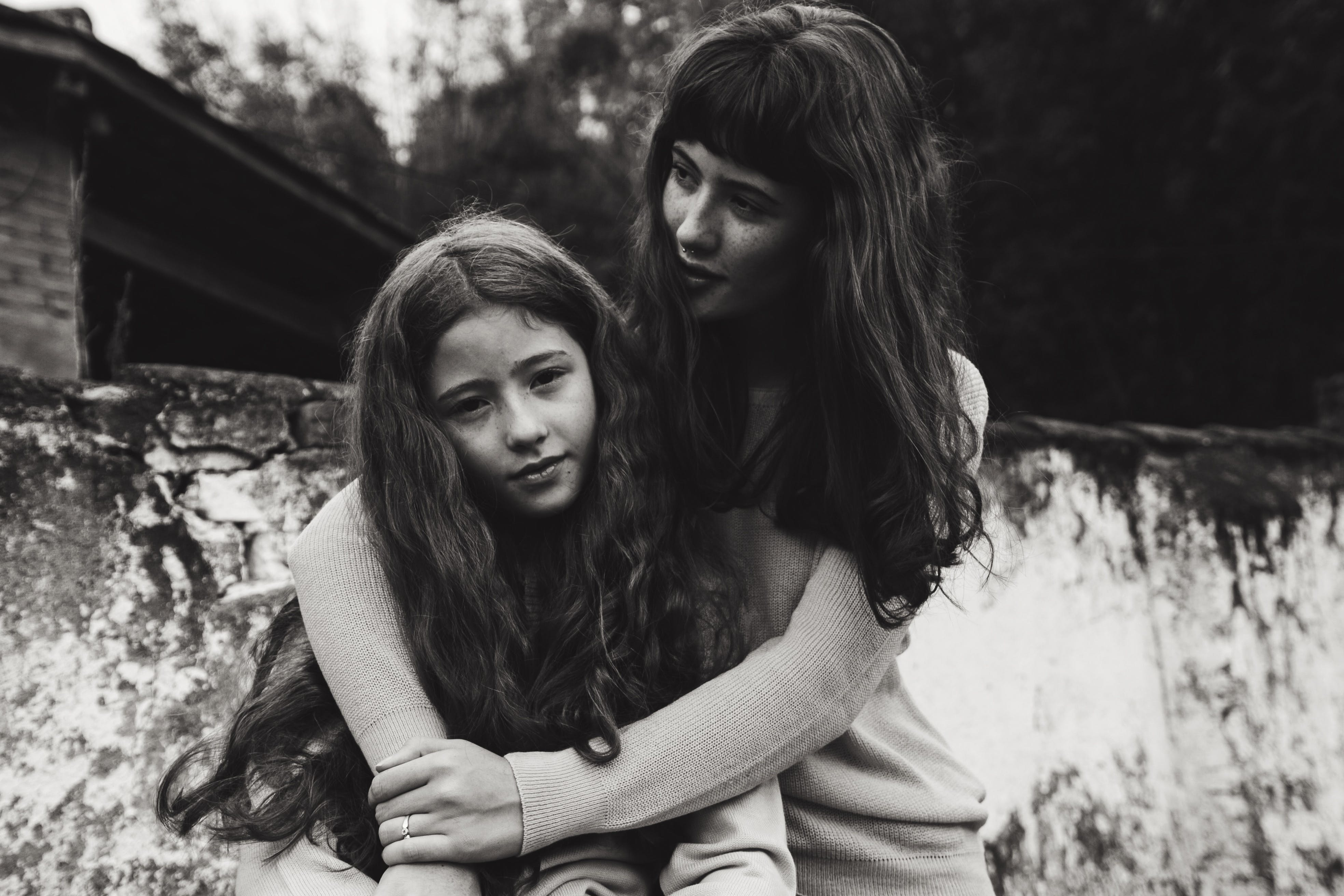 Grayscale Photo of Woman and Girl With Long Hair