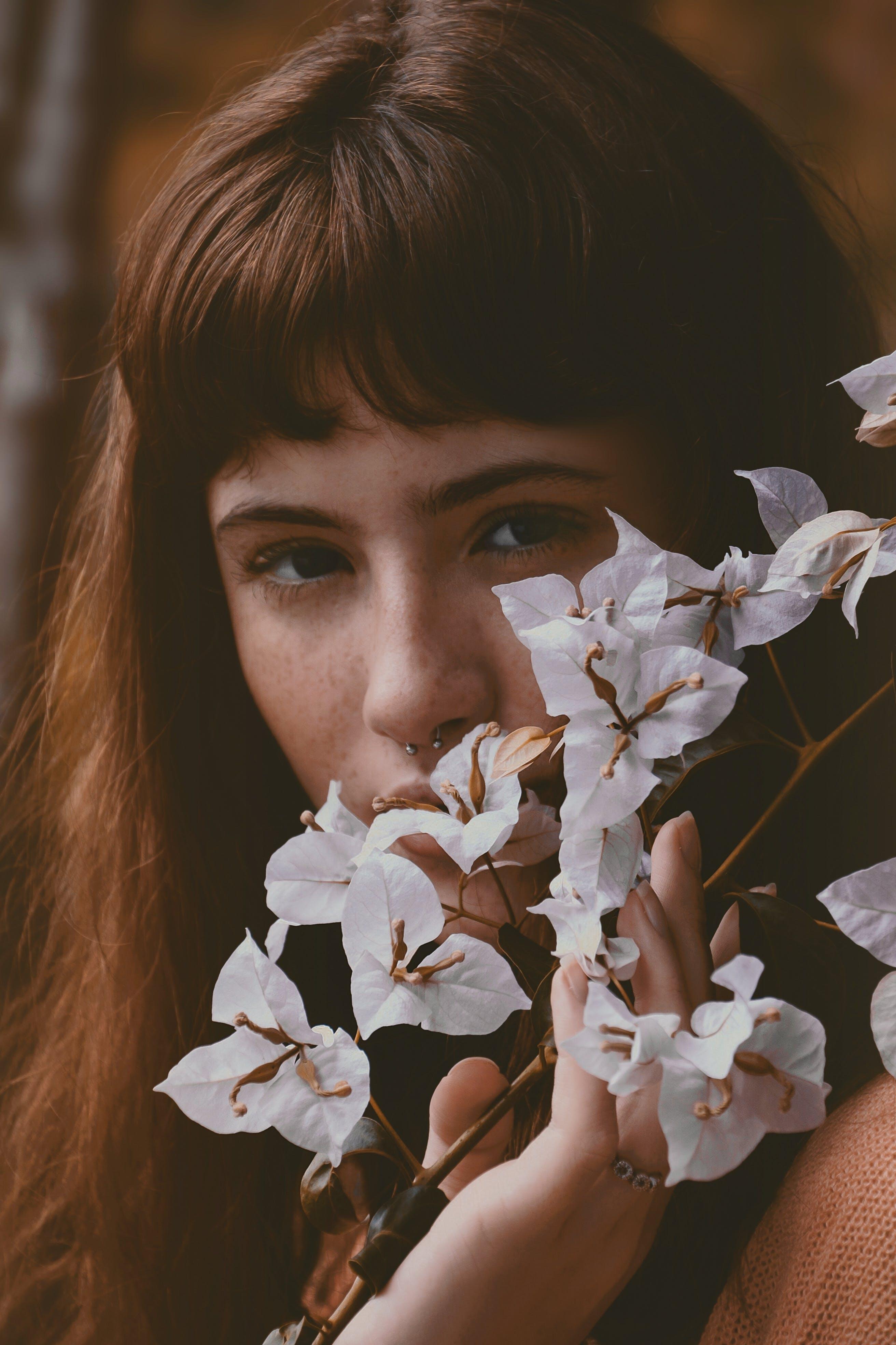 Woman Touching White Petaled Flower