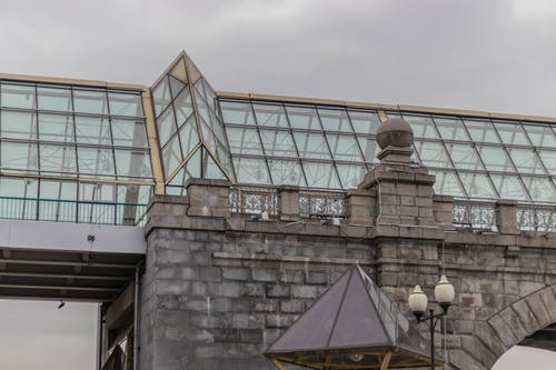 Free stock photo of bridge, glass, grey sky