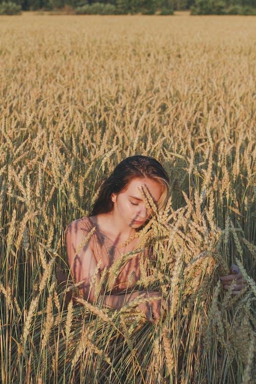 Woman Hiding on Field