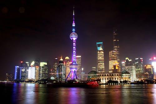 Ingyenes stockfotó éjszaka, felhőkarcolók, hosszú expozíció, láthatár témában