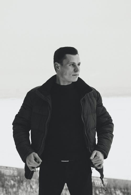 Grayscale Photography of Man Wearing Bubble Jacket