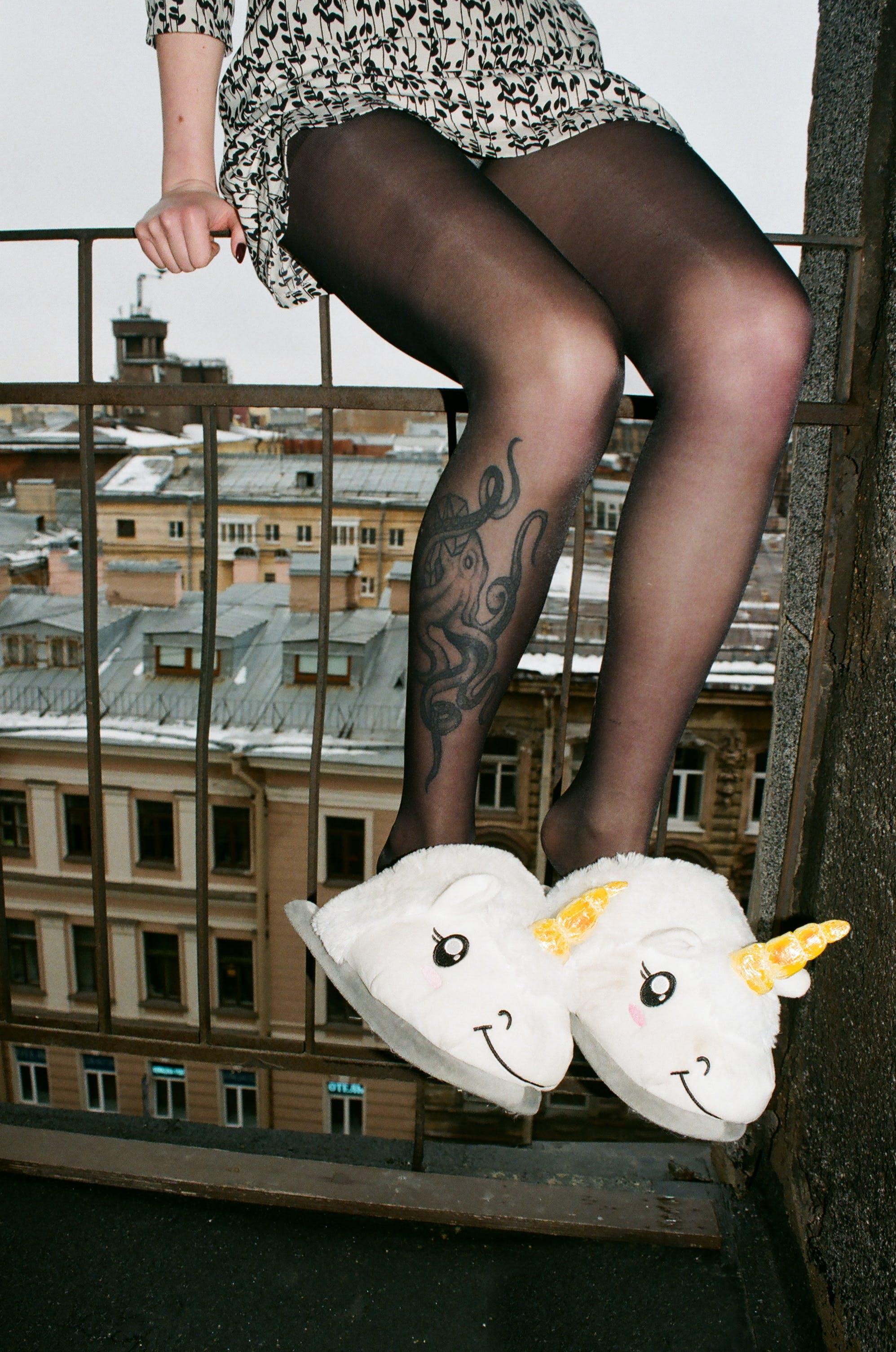 Person Wearing Unicorn Slippers